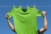Hand hanging shirt. — Stock Photo