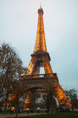 Eiffel Tower, Paris,France  in evening fog. — Stock Photo