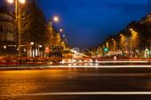 Parisian Champs Elysees in evening, — Stock Photo