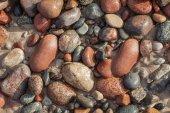 Pebbles in sand. — Stock Photo