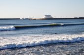Waves and surfers at Porto, Portugal. — Stock Photo