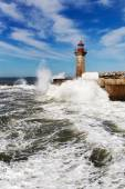 Waves on brekwater in Porto, Portugal. — Stock Photo