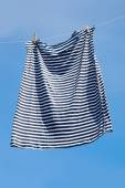 Drying of striped shirt. — Stock Photo