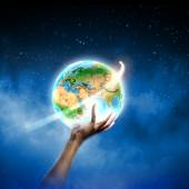 Human hand holding Earth planet — Stock Photo