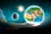 Human hand holding Earth planet — Stockfoto