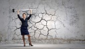 Businesswoman with hammer in hands — Stock Photo