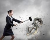 Businesswoman crashing dollar symbol — Stock Photo