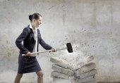 Businesswoman crashing bricks — Stock Photo