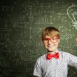 Genius boy near blackboard with formulas — Stock Photo #52029023