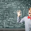Genius boy near blackboard with formulas — Stock Photo #52029425