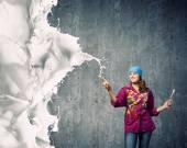 Painter with brush and white splashes — Stock Photo