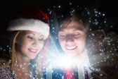 Man and woman opening Christmas gifts — ストック写真