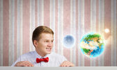 Man looking at Earth planet — Stock Photo