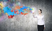 Woman and colorful splashes. — Stockfoto