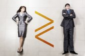 Bossy businesswoman and businessman — Stock Photo