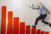 Businessman running on increasing graph — Stock Photo