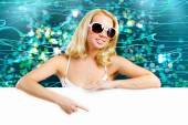 Woman in sunglasses with blank banner — Stock Photo