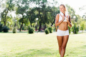 Attractive sport girl in park — Stock Photo