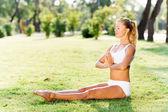 Woman sitting in lotus pose — Stock Photo