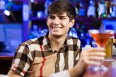 Young man in bar — Stock Photo
