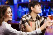 Young couple in bar — Stock Photo