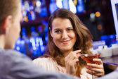 Couple in bar having drinks — Stock Photo