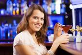 Girl at bar drinking cocktail — Stock Photo