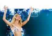 Girl in bikini with banner — Stock Photo