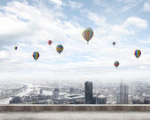 Balloons flying high in sky — Stock Photo