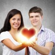Couple holding red heart — Stock Photo #52271789