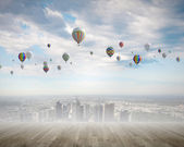 Colorful balloons flying high in sky — Stock Photo