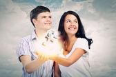 Couple holding pound sign — Stock Photo