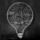 Light bulb on black wall — Stock Photo
