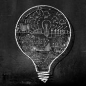 Light bulb on black wall — Stock Photo
