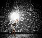 Businesswoman carrying light bulb — Foto de Stock