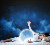 Girl lying in bed with moon — Foto de Stock