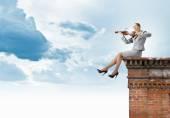 Businesswoman playing violin — Stock Photo