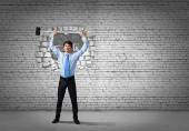 Businessman with hammer in hands — Stock Photo