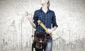 Woman mechanic with ruler in hand — Stock Photo