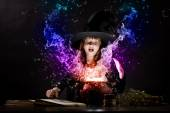 Little witch reading conjure — Stock Photo