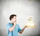 Man holding book with euro sign — Stock Photo