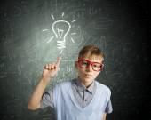 Schoolboy having idea — Stock Photo