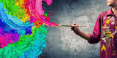 Handsome man painter with brush — Stock Photo