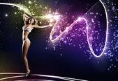 Woman in bikini dancing — Stock Photo