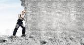 Strong man pushing wall — Foto Stock
