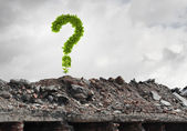 Green question mark growing on ruins — Stock Photo