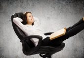 Businesswoman sitting with book — Stock Photo