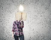 Woman  hiding face behind reading — Stock fotografie