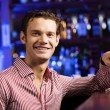 Handsome man sitting at bar — Stock Photo #52589099