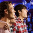 Young men watching match — Stock Photo #52589389